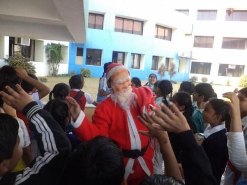 View the album Riding on a sleigh Santa came to SNV